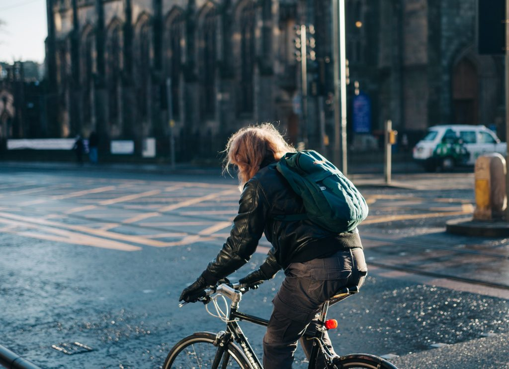 Riding your bike to work each day can boost your positivity and brain power.
